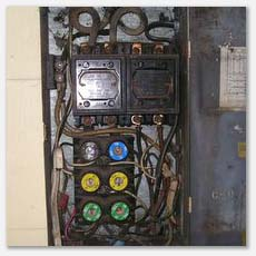 This overloaded fuse box raised a red flag.  It is the main supply to a multi family complex. Seriously overloaded.