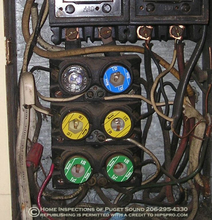 overloaded fuse box multiple tapping and knob and tube wiring click this picture for a closeup